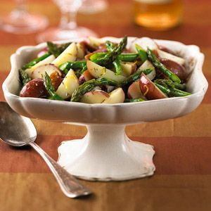 This healthy side dish showcases fresh asparagus and new potatoes with a touch of lemon and thyme.