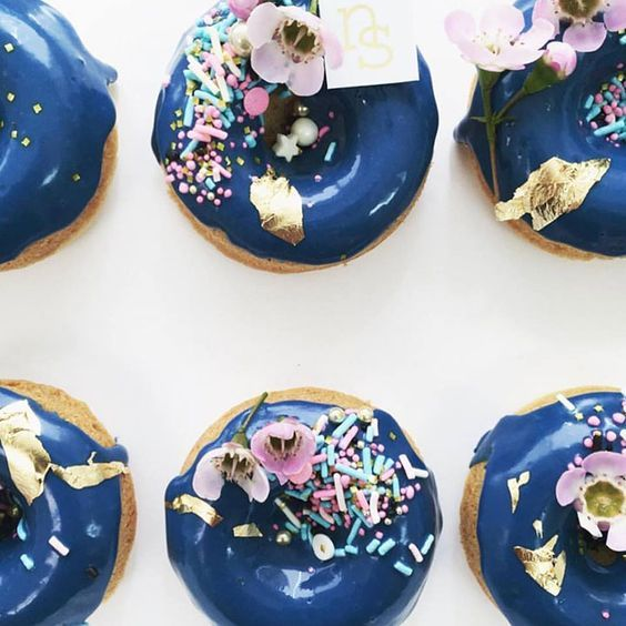 Incredibly unique blue donut wedding dessert idea; Featured Dessert: Nectar and Stone