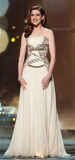 Anne Hathaway: Oscars 2011. She didn't wear this on the red carpet actually, but  while she was hosting. I just love the simplicity and pureness of this dress. It's just pretty to me