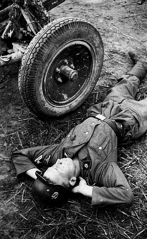 German soldiers sleeping on the ground.