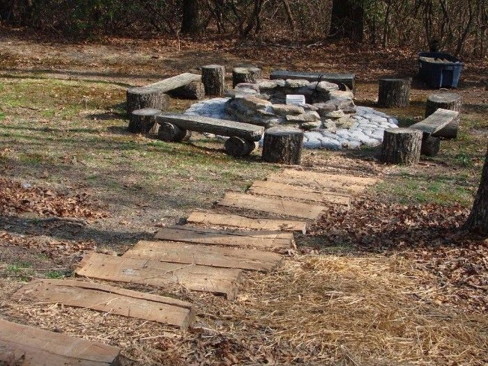 bonfire pit in the woods.  this would work perfect in our large wooded back lot.