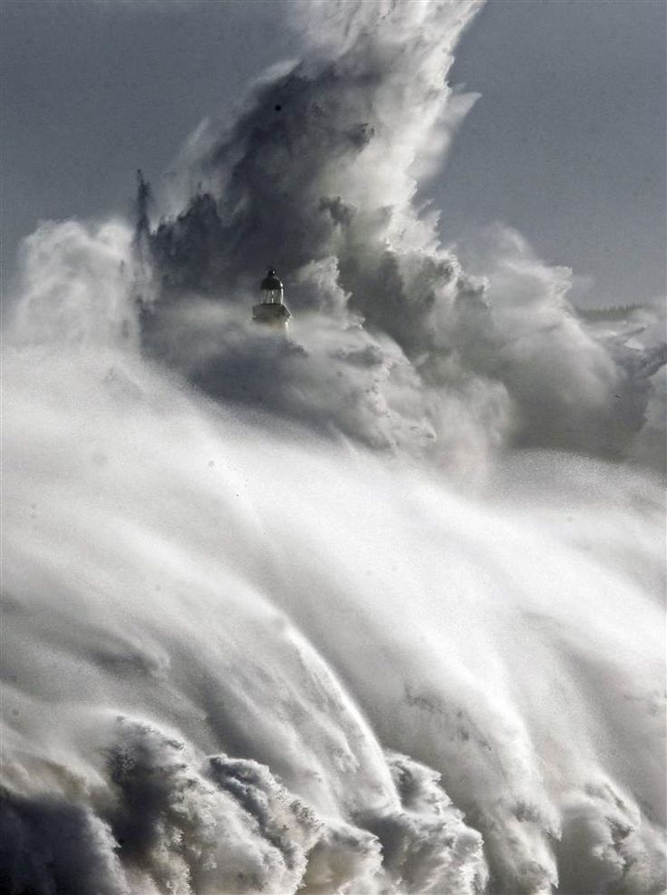 Large waves almost cover the lighthouse in Mouro island in front of port in Santander, northern Spain, Feb. 2. Spanish authorities issued a ...