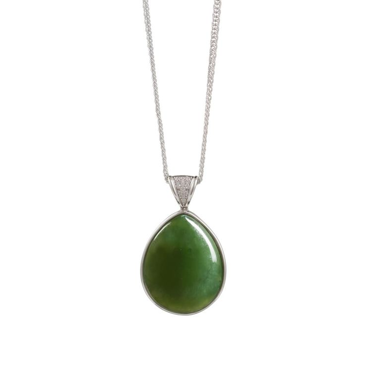 Small New Zealand Pounamu Necklace - It has delicate koru patterns in silver on its' back
