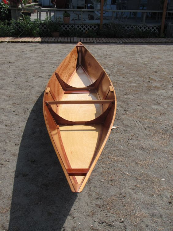 14 feet 10 inches 30# Lightweight Marine Mahogany Plywood 4mm sides, 6mm bottom Solid mahogany chines gunwale and ribs Stainless steel fasteners 3M- 5200 Marine glue 7 coats of Daleys sea-fin marine oil finish Solo pirogue