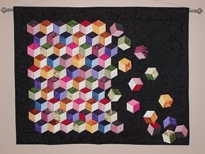 This log cabin baby quilt pattern has bear blocks as the center block for the log cabin design. Description from koluern.net. I searched for this on bing.com/images