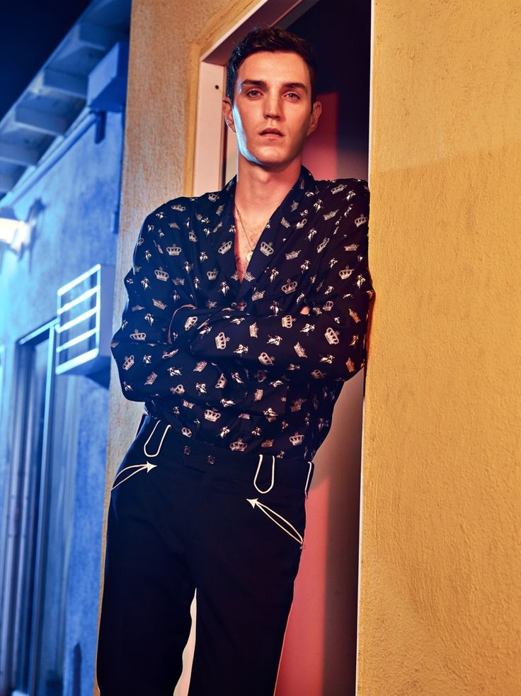 Josh Beech taps into Dolce & Gabbana's western themed fall with a patterned shirt and detailed pants.