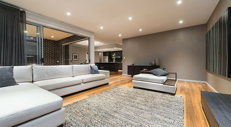 The open living room is connected to the kitchen and dining area, giving a lovely flow through this home. #living #lounge