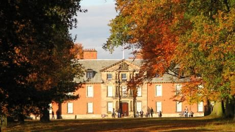 A view of Dunham Massey Hall and autumnal trees