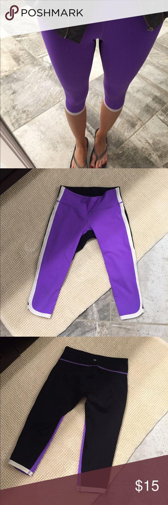 Lululemon capri leggings Purple, black and white capri leggings. Very good condition. lululemon athletica Pants Track Pants & Joggers