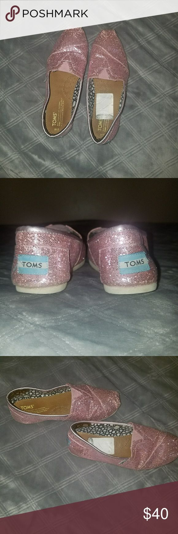 Sparkly Pink Toms Size 8 Good condition. Hardly worn. Selling because they're too big for me Toms Shoes Flats & Loafers