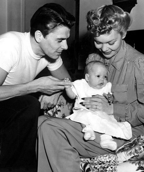 Ronald Reagan and (first wife) Jane Wyman at home with their daughter Maureen