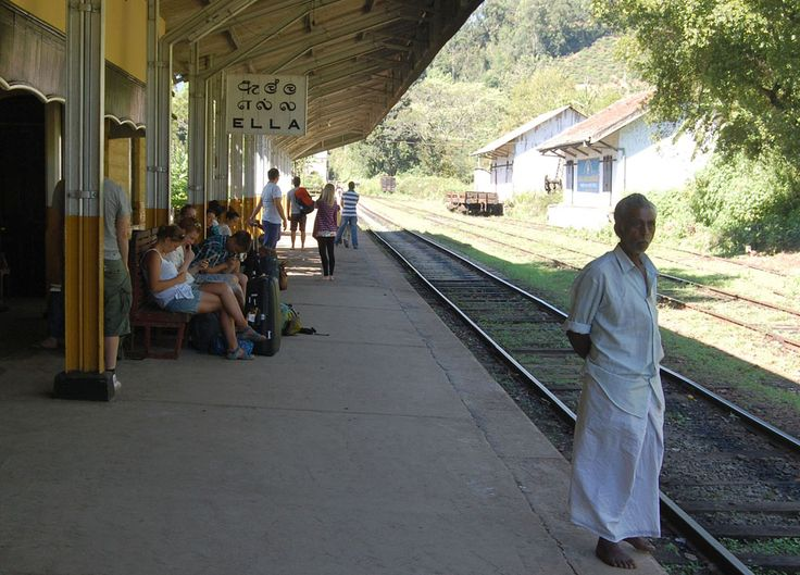 Sri Lankan man standing at the tracks waiting for train at the old colonial train station in Ella tea hills (Wellawaya) in South Sri Lanka. Check our blog for full story of our South Sri Lanka Tour and Guide for Independent Travel in Southeast Asia. Here: http://live-less-ordinary.com/southeast-asia-travel/south-sri-lanka-tour-independent-travel