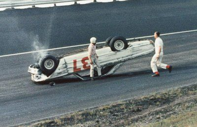 vintage nascar pics   Bob Strickler climbs out of his overturned Ford after a crash in the ...