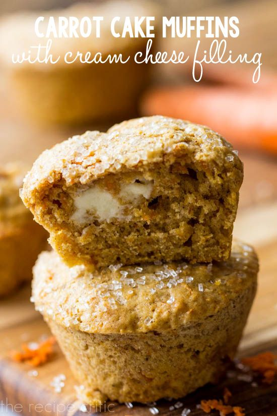 Carrot Cake Muffins with a cream cheese filling at http://therecipecritic.com Perfectly delicious and moist carrot cake muffins with a cream cheese center!!