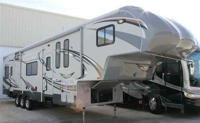 2011 Used Heartland Cyclone Toy Hauler in Florida FL.Recreational Vehicle, rv, 2011 Heartland Cyclone model 370C HD edition. Excellent condition. 44' overall, but tows like it's 39' due to the unique cabover design. 12' Garage. One full bath, and a half bath in garage area. Cyclone Package: Aluminum Wheels, 8 cu. ft. Refrigerator, Fantastic Vent w/Rain Sensor in Kitchen, 12 Gallon Water Heater, 15,000 BTU A/C, 50 Amp Service, 30 inch Residental Microwave Oven, Glazed Cherry Wood, Hidden…