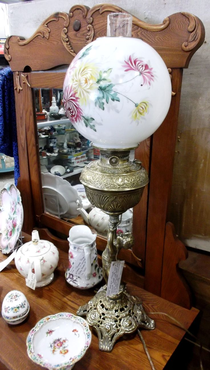 This antique cherub lamp has a solid brass base with a hand painted milk glass globe. Converted from oil to electricity it is available in P804 for $445.00.  1400 Squires Beach Road, Pickering, ON L1W 4B9. 905) 427-7902. www.roadshowantiquespickering.com