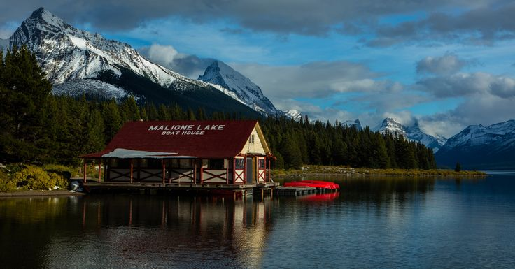 maligne lake boathouse - A nice reflection and a different view of Malign Lake in the Canadian Rockies including the boathouse. The light was best on this side so i photographed in this direction.