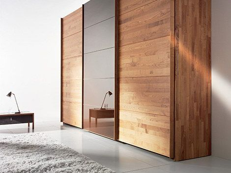 Attractive Wooden Wardrobe And Close With Sliding Door Design by Valore For Bedroom Interior Ideas