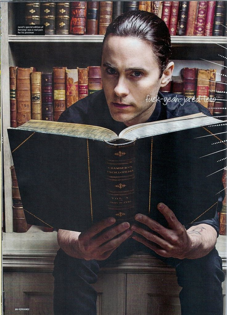Sexy man with a big book