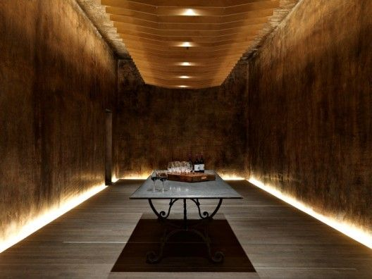 The cellar and our senses.  Cellars are often associated with wine and food and this project at a Yalumba Winery by Grieve Gillett  finds re-use for a cellar that continues this connection.  A sense of warmth and safety is created with a lighting and use of material.