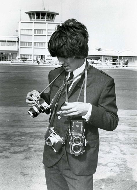 George Harrison with various cameras | 33 Celebrities With Their Cameras
