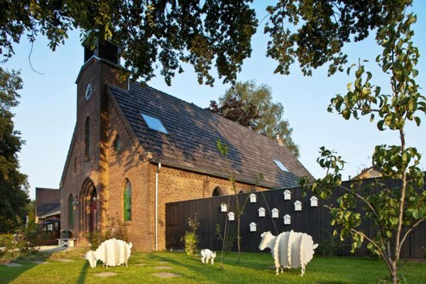 Dutch Church Transformation - playful nod to its original function with flock and homes for doves (may be)