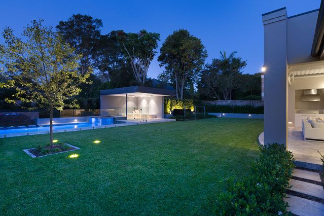 Exterior at night - Chateau Architects + Builders