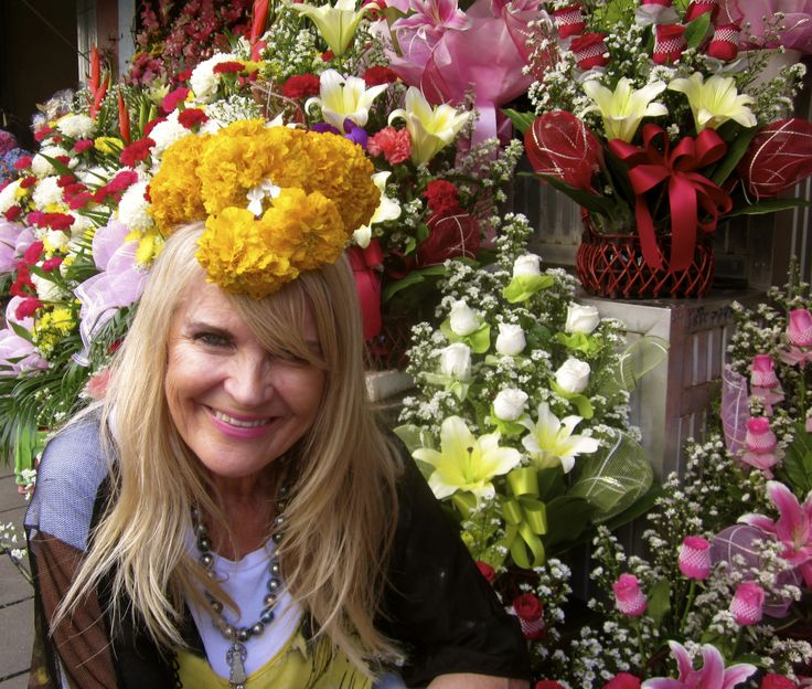 Carmel amongst the gorgeous flowers during her trip to Thailand.