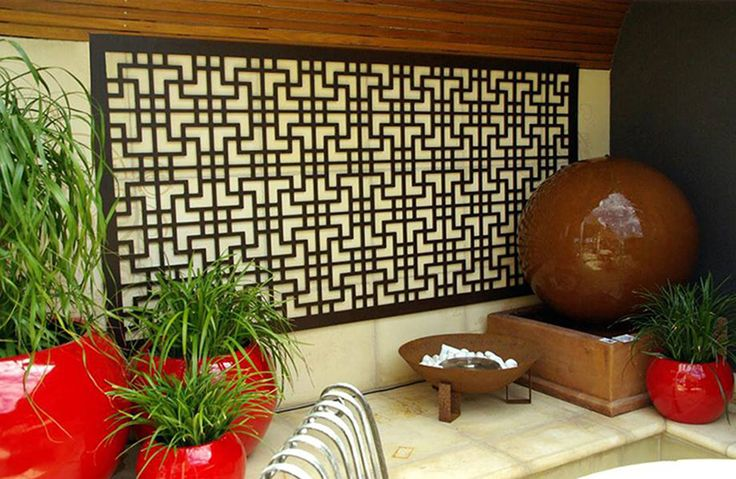 QAQ's decorative screen as wall decor in a Japanese style patio. This is the 'Tokyo' screen design in compressed hardwood.