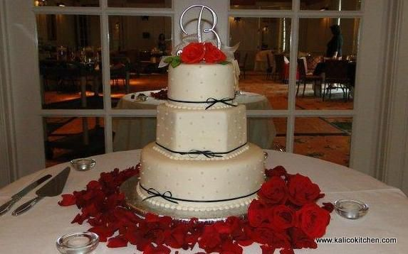 Wedding Cakes- 3 tier, fondant, hexagonal tier, navy blue ribbon, sugar pearls
