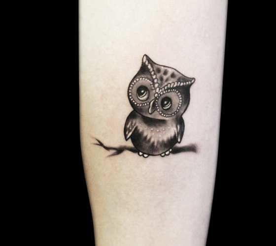 Prety black and grey small owl tattoo by artist Radu Rusu Tattoo