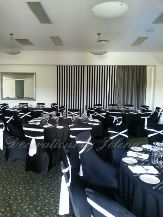 Dramatic ultra modern black and white wedding reception decor