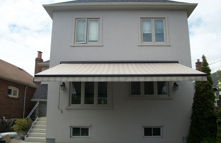 Rolltec awning installed over stucco #Rolltec #DeckandPatio #awnings #landscaping #outdoorspaces