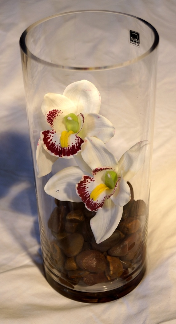 Tall Vase with Brown Rocks & White Orchids $30.00