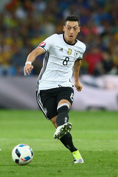Mesut Oezil of Germany runs with the ball during the UEFA EURO 2016 Group C match between Germany and Ukraine at Stade Pierre-Mauroy on June 12, 2016 in Lille, France.