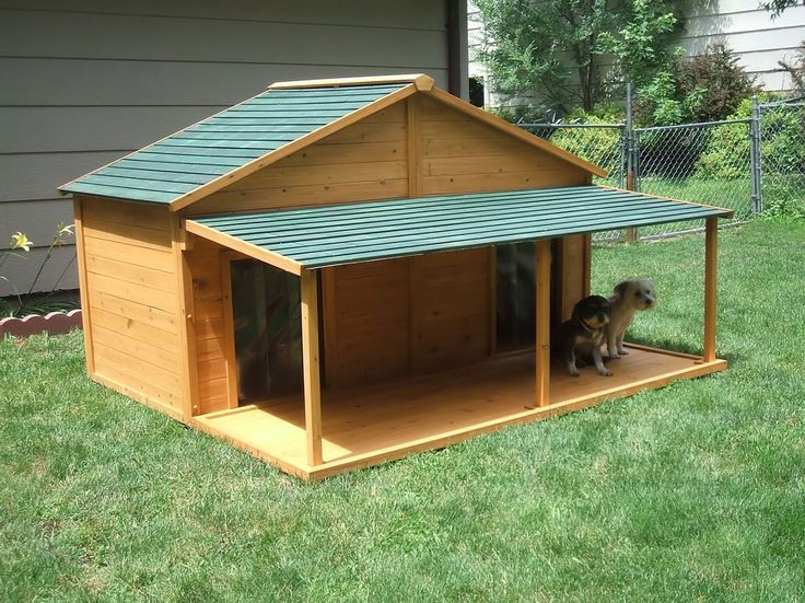 insulated dog house example: build with hinged roof on one side for easy clean out and only one door.  Add shuttered screened windows on each gable end for summer ventilation.