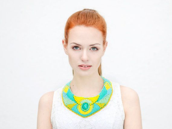 This unique embroider necklace was made with bright, playful colors. The mane colors of necklace are: Three different size of YELLOW - (cold,