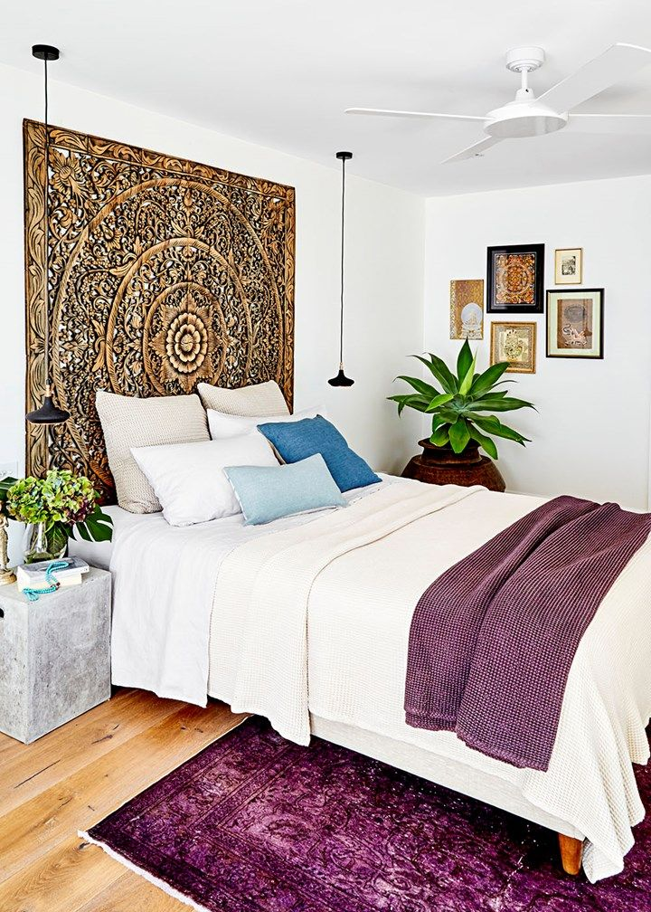 The downstairs rumpus room was converted to the main bedroom, with a stunning lotus wall panel, found in Chiang Mai, forming the bedhead.
