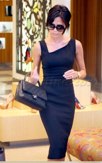 Victoria Beckham in Victoria Beckham dres chanel purse FABRIC: http://www.moodfabrics.com/donna-karan-black-stretch-wool-suiting-fw11626.html