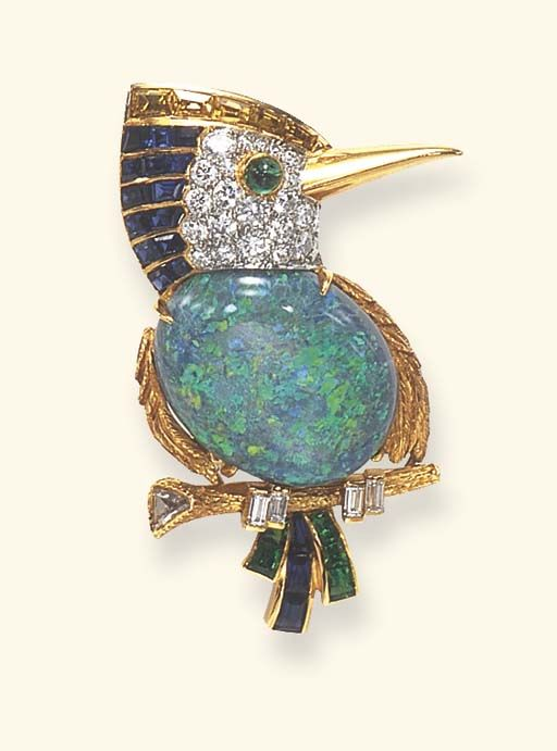 A MULTI-GEM BIRD BROOCH, BY CARTIER  Designed as a textured and sculpted gold kingfisher, with an opal body, a pavé-set diamond head and cabochon emerald eye, enhanced by calibré-cut sapphire, yellow sapphire and emerald feathers, a polished gold beak, and baguette-cut diamond claws perched upon a textured and sculpted gold branch accented by a triangular-cut diamond, mounted in gold