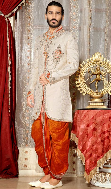 Leave onlookers awe struck by wearing this cream brocade men's dhoti sherwani. The moti, patch, resham and stones work looks chic and great for any occasion. Brocade might vary from actual image. #Men'sSherwani