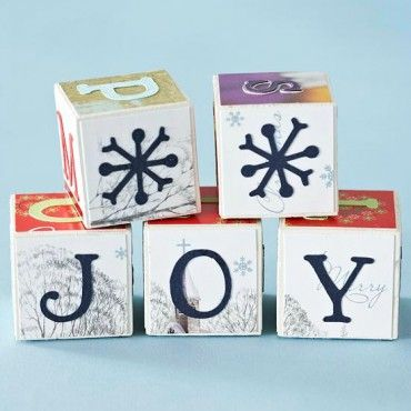 How about these cute blocks? Simple wooden cubes, cut out squares, buy pre-cut letter stickers (or use a cricut machine to cut out letters) and a little decopauge – and look at these cute blocks you have to display!  Inspired by Better Homes & Garden.