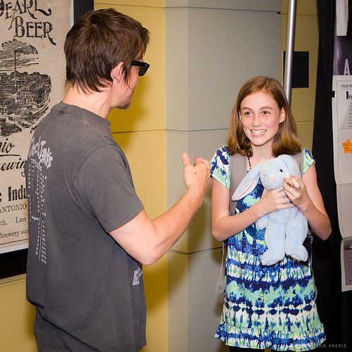 Norman Reedus talks with his Walking Dead co-star, Madison Lintz