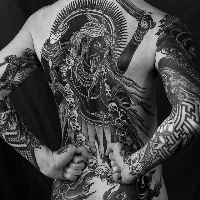 Blackwork backpiece by Alexander Grim.                                                                                                                                                                                 More