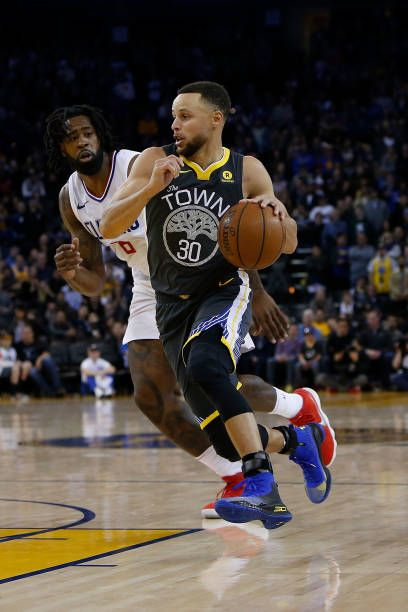 Stephen Curry of the Golden State Warriors gets by DeAndre Jordan of the Los Angeles Clippers as he drives to the basket at ORACLE Arena on February...