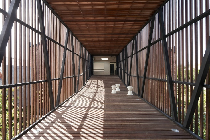 A bridge to connect the two primary buildings in the renovation of the Golden Crust Bakery into a family home by Jackson Clements Burrows Architects