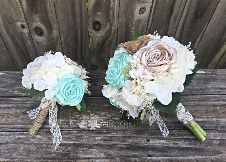"Custom Ordered Bridal Package (1) 10"" Bridal bouquet (1) Mini Bride Bouquet (1) Groom boutonnière (1) Ring bearer bow tie Beautifully handcrafted Tiffany blue/aqua and champagne roses paired with burlap roses, Baby's breath and artificial ivory hydrangeas."