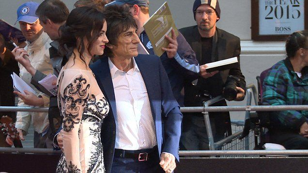 Ronnie Wood on the red carpet with his wife Sally Humphreys at the GQ awards in London.