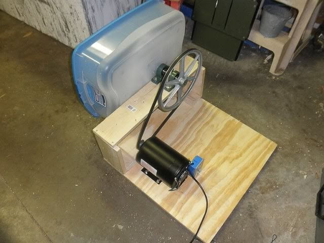 Polisher by rykk -- Homemade polisher constructed from a leather polishing head, plastic bin, electric motor, pulley, and plywood. http://www.homemadetools.net/homemade-polisher-6