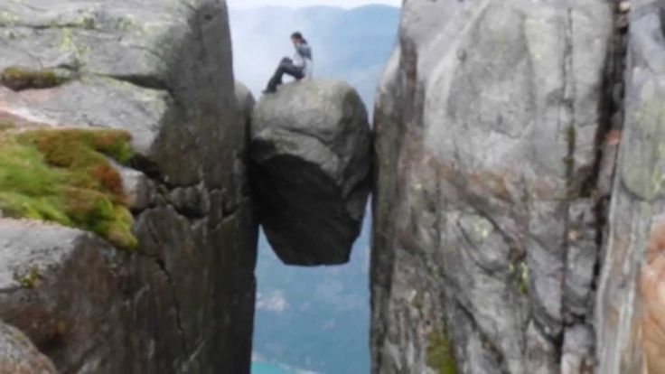 At the Kjeragbolten in Norway: Behind the ScenesThere is no experience quite like it - getting into the Kjeragbolten, a 5 cubic metre stone located between two rocks in the Kjerag, a Norwegian mountain located in Lysefjorden which is a few hours drive from Stavanger in Norway..